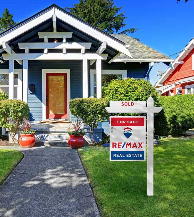 photo of a home with Re/Max Sold sign